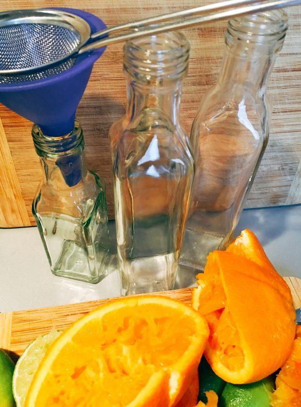 Orangen, Limetten ausgepresst für zuckerfreien Ingwersirup